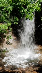 The beautiful 6 metre high waterfall usually flows all summer